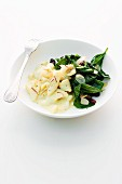 Chunks of sole with almond spinach