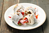 Rollmops filled with pepper strips and pickled gherkins