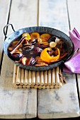 Stewed plums with cinnamon and orange peel