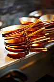 Stacked copper pans in a restaurant kitchen