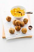 Deep-fried chocolates with mango compote