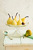 Spiced pears with star anise on a cake stand