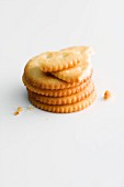 A stack of crackers and pieces of cracker