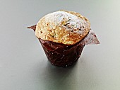 A muffin in baking parchment