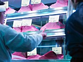 Pieces of tuna fish for sale in a chiller