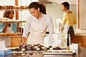 Woman packing baked goods at bakery
