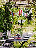 Table in garden ready for childrens party