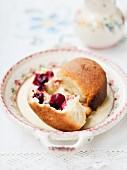 Buchteln (baked, sweet yeast dumpling) with cherries and custard