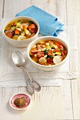 Vegetable soup with beans, bacon and sausage