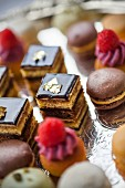 Petit fours on an elegant, silver cake stand