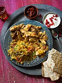 Chicken tagine with couscous and flatbread