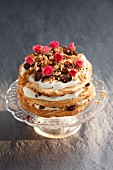 Chocolate meringue layer cake with sesame brittle, caramel and rosebuds