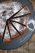 Piece of Midnight Chocolate Sheet Cake with Powdered Sugar