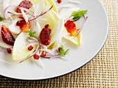 Winter salad of chicory, blood orange, pomegranate and red onion