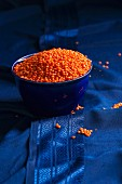 Red lentils in a blue bowl on a blue silk sari
