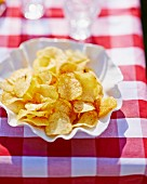 Potato chips in a paper dish