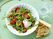 Salsiccia with red lentils, rocket and tomatoes