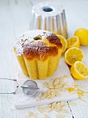 A mini lemon Bundt cake with flaked almonds