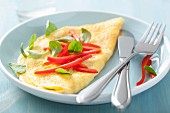 An omelette with pepper and basil