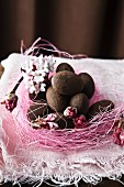 Chocolate covered almonds in an Easter nest