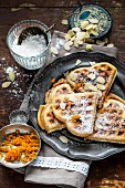 Heart-shaped waffles with slivered almonds and orange zest