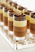 Tricoloured chocolate mousse in glasses
