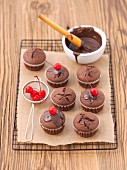 Chocolate muffins with glace cherries