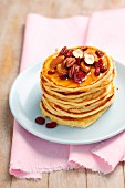 Buttermilk pancakes with nuts, dried cranberries and honey