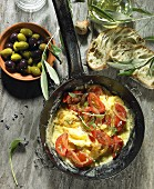 Tomato scrambled eggs with onions, black and green olives, olive oil, an olive spring, olive ciabatta and lavender