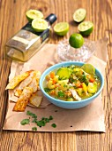 Lime soup with avocado, tomatoes, chicken and tortilla chips
