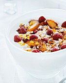 Yogurt with muesli, raspberries and fried apples