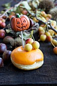 A Halloween doughnut filled with chestnut cream decorated with icing sugar and cake pop
