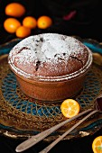 Chocolate soufflé with kumquats