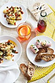 Various antipasti with bread and drinks (Italy)