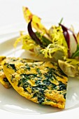 Spinach frittata with a bitter vegetable salad