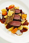 Saddle of venison with parsnips, kumquats and juniper cake