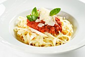Tagliatelle with tomato sauce and Parmesan cheese