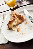 A half-eaten croissant