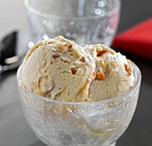 Macadamia nut ice cream in a glass bowl