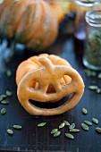 A pumpkin-shaped cake made from doughnut batter