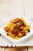 Tagliatelle with tomatoes and capers