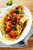 Swabian ravioli with wild garlic and tomatoes