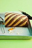 A striped Swiss roll with apricots and amaretto cream