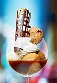 An ice cream sundae with coffee sauce
