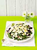 A mixed leaf salad with radishes and quail's eggs