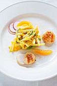Scallops with a sweet potato and mango salad, mandarins and radishes