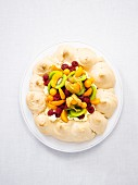 Pavlova with fresh fruits (seen from above)