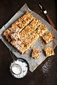 Muesli bars made with almonds, berries and icing sugar