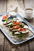 Chicken with coconut sauce, lemongrass and coriander on a bed of rice (Asia)