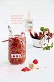 A jar of rhubarb and raspberry compote